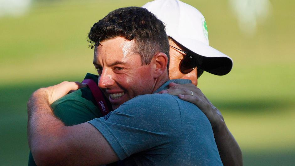 Rory McIlroy of Ireland embraces a member of his team after being eliminated in the bronze medal play-off. REUTERS/Toby Melville