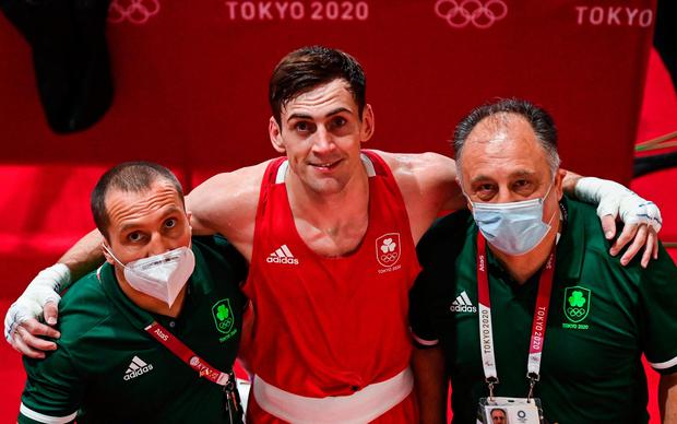 Aidan Walsh of Ireland with coaches Dmitry Dmitruk, left, and Zaur Antia, right, after defeating Mengue Ayissi of Cameroon in the Men's Welterweight Round of 16 at the Kokugikan Arena during the 2020 Tokyo Summer Olympic Games. Photo by Ramsey Cardy/Sportsfile