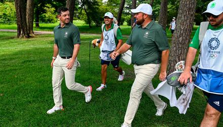 Rory McIlroy, left, and Shane Lowry of Ireland walk to the third tee box