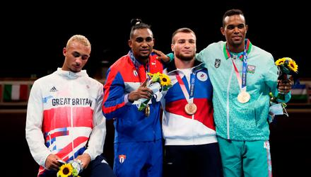 Men's Light Heavy (75-81kg) medalists (L-R) Benjamin Whittaker of Team Great Britain (silver medal), Arlen Lopez of Team Cuba (gold medal), Imam Khataev of Team Russian Olympic Committee (bronze medal) and Loren Berto Alfonso Dominguez of Team Azerbaijan (bronze medal) pose for photographs