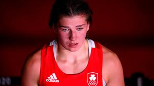 Aoife O'Rourke shows her disappointment after her defeat to Qian Li of China in their middleweight bout. Photo: Sportsfile