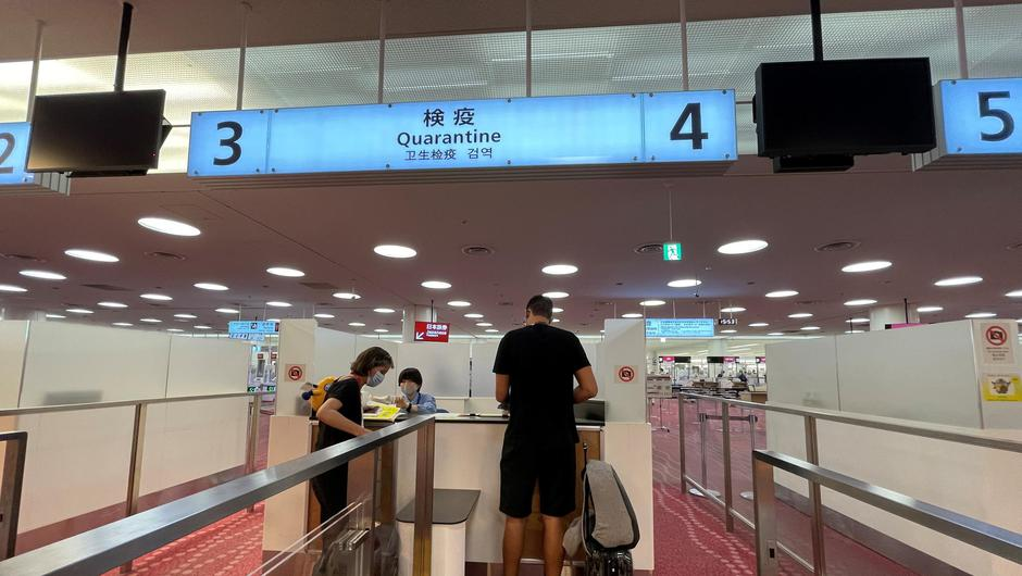 Members of the media go through a quarantine paperwork check at Haneda Airport ahead of the Tokyo 2020 Olympic Games. Photo: Lucy Nicholson/Reuters