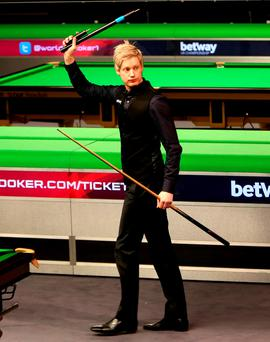 Neil Robertson celebrates beating John Higgins during day ten of the 2015 Betway UK Snooker Championship at The York Barbican, York