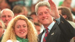 US President Bill Clinton waves to the press as he stands alongside Michelle Smith at the Georgia Tech aquatics centre during the 1996 Atlanta Olympics. Clinton sympathised with Smith for all the 'crap' she had to deal with during the games. Picture: AFP via Getty Images