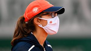 A ball girl is seen wearing a Roland Garros face mask as she looks on during day one of the 2020 French Open at Roland Garros on September 27, 2020 in Paris, France. (Photo by Shaun Botterill/Getty Images)