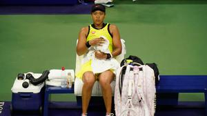 Naomi Osaka sits on the bench between games during her defeat to Leylah Fernandez in the third round of the US Open.(AP Photo/Frank Franklin II)