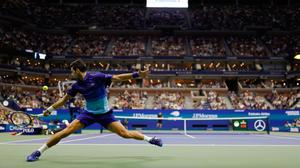 Novak Djokovic reaches for a backhand against Jenson Brooksby on Day 8 of the US Open at USTA Billie Jean King National Tennis Center at Flushing, NY.