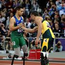 Gold medal winner Alan Oliveira, left, shakes hands with Oscar Pistorius after the men's 200m T44 race at London 2012 (AP/Matt Dunham)