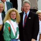 President Bill Clinton meets Michelle Smith after she won the third of her three gold medals at the 1996 Olympics. Photo: Getty