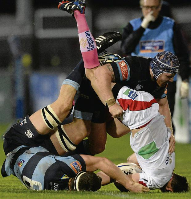Ulster's Ruan Pienaar is tackled by Cardiff duo Robin Copeland, left, and Marc Breeze during their Pro 12 clash at Ravenhill OLIVER MCVEIGH/SPORTSFILE