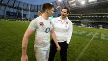 Andy Farrell, then England assistant coach, congratulates his son and fly-half Owen (left) after their Six Nations win over Ireland at the Aviva in 2013. Photo: Getty