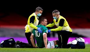 Ireland captain is tended to by team physio Keith Fox, left, and team doctor Dr Ciarán Cosgrave before being replaced during the Six Nations defeat to Wales last Sunday. Photo: Gareth Everett/Sportsfile