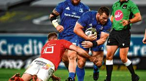 Carry on: Leinster's Cian Healy is tackled by Munster's JJ Hanrahan. Photo: David Fitzgerald/Sportsfile