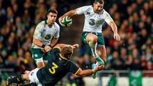 Rob Kearney hurdles over a tackle from Jannie du Plessis of South Africa during their clash at the Aviva