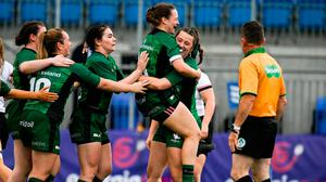 Shannon Touhey of Connacht celebrates after scoring her side's first try with team-mate Catherine Martin during the Vodafone Women's Interprovincial Championship match against Ulster at Energia Park in Dublin. Photo: Harry Murphy/Sportsfile