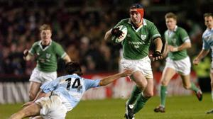Anthony Foley avoids the tackle of Argentina's Lucas Borges during the November 2004 international at Lansdowne Road. Photo: Matt Browne/Sportsfile
