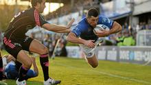 Leinster's Rob Kearney, main, dives over to score his side's third try.