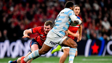 Chris Farrell struggles to get to grips with Racing 92's Virimi Vakatawa during yesterday's Champions Cup clash. Photo: Sportsfile