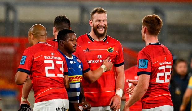 RG Snyman, centre, and Ben Healy of Munster share a joke