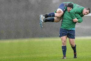 Mike Ross gives fellow prop Cian Healy a lift during training at Carton House this week in preparation for today's clash with England sportsfile