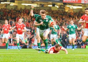 Tommy Bowe leaves Welsh winger Shane Williams clutching at straws as he goes over for Ireland's second try in the famous Grand Slam game of 2009   Photo: Sportsfile