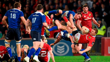 Andrew Conway and Eoin Reddan take a tumble while competing for a ball Photo:Sportsfile