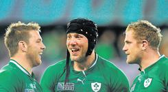 Sean O'Brien, Stephen Ferris and Jamie Heaslip celebrate after an Irish victory - the IRFU is remaining tight-lipped on the speculation surrounding O'Brien and Heaslip