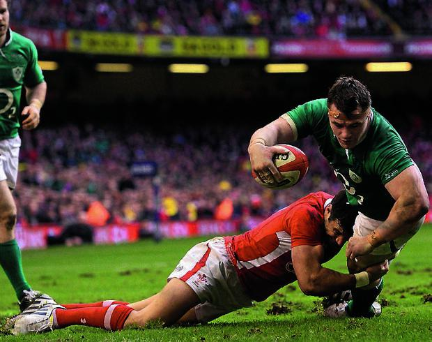 2 February 2013; Cian Healy, Ireland, goes over for his side's second try, despite the tackle of Mike Phillips, Wales. RBS Six Nations Rugby Championship, Wales v Ireland, Millennium Stadium, Cardiff, Wales. Picture credit: Stephen McCarthy / SPORTSFILE