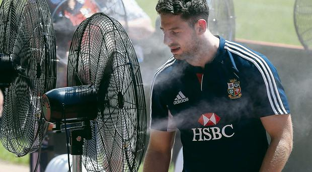 Alex Cuthbert cools down using mobile outside air conditioning fans