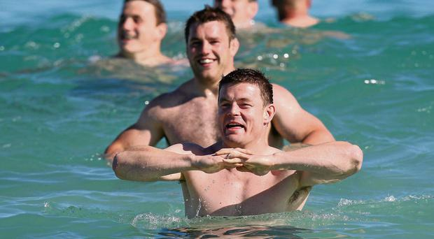 Brian O'Driscoll can see the funny side as he enjoys a dip in the sea off Perth's City Beach along with Sean O'Brien and his other Lions team-mates