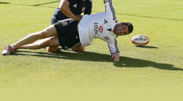 Rob Kearney feels the strain as he receives treatment from Lions physiotherapist Prav Mathema in Perth yesterday
