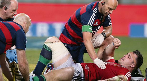 Cian Healy of the Lions is treated for a leg injury during the tour match against Western Force and the