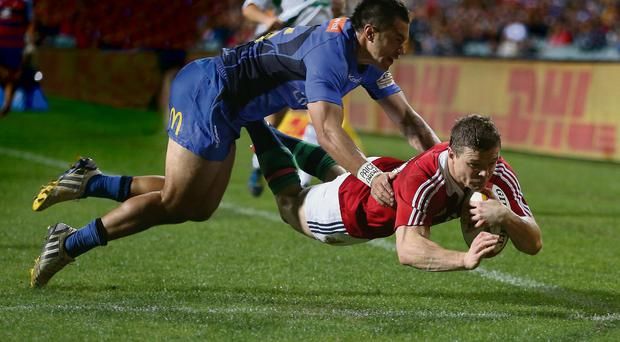 Brian O'Driscoll dives over to score the first of his two tries against Western Force