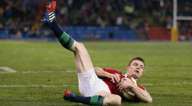 Brian O'Driscoll dives over for a try during the match against Combined Country