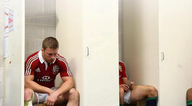 A dejected Sean O'Brien sits in the Lions dressing-room after losing 14-12 to the Brumbies