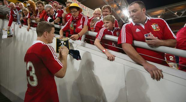 Brian O'Driscoll signs autographs for Lions fans after the 23-21 victory over Australia at the Suncorp Stadium in Brisbane