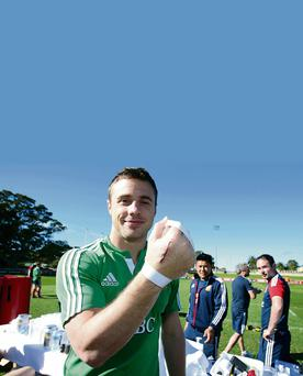 Tommy Bowe shows off the large scar on his right hand - the Irish star is set to make a sensational return to action on Saturday