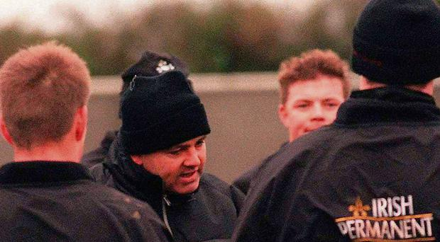Brian O'Driscoll listens in as then-Ireland coach Warren Gatland gives a team-talk in Greystones in 2000