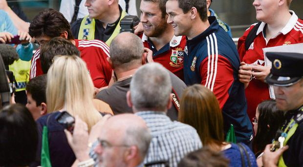 Jonathan Sexton and Sean O'Brien pose for a photograph on their arrival at Dublin Airport following the Lions' series victory over Australia