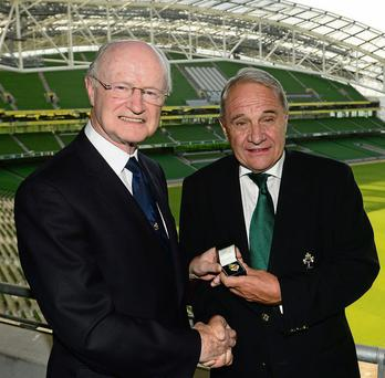Outgoing IRFU president Billy Glynn (left) hands over the badge of office to the incoming president Pat Fitzgerald at the Aviva Stadium