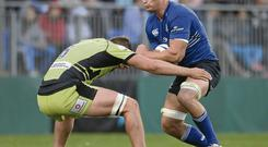 Leinster's Rhys Ruddock is tackled by Calum Clark of Northampton Saints at Donnybrook last night