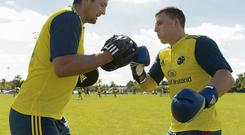Andrew Crowley (right) and James Downey pull no punches during Munster's training session at the Cork Institute of Technology yesterday