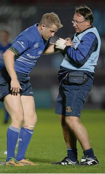 Luke Fitzgerald with Dr John Ryan after picking up an injury during the second half in Parc y Scarlets. STEPHEN McCARTHY