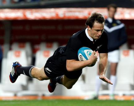 New Zealand All Blacks' Ben Smith dives to score a try against Argentina
