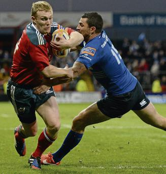 Munster's Keith Earls evades the tackle of Rob Kearney on his way to scoring his try