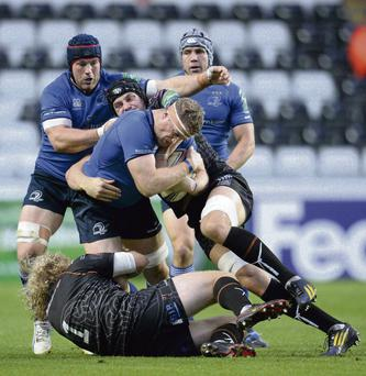 Jamie Heaslip is tackled by Duncan Jones and James King at the Liberty Stadium. Photo: Stephen McCarthy