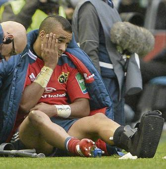 Simon Zebo sits on the pitch in Murrayfield after breaking a bone in his foot that sees him wearing a protective boot for the second time this year