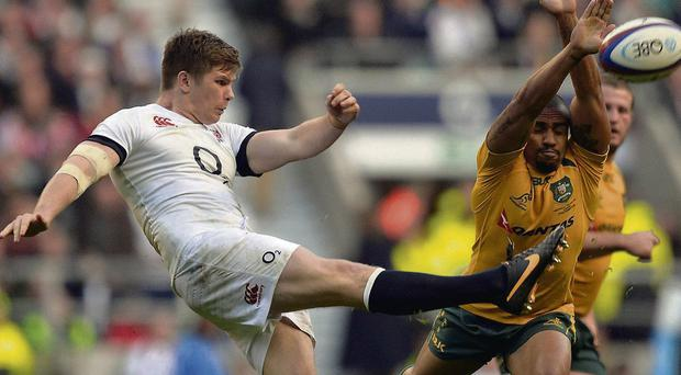 England's Owen Farrell clears the ball as Australia's Will Genia attempts to block his kick at Twickenham on Saturday