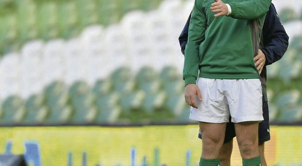 Paddy Jackson goes through his place-kicking drill with coach Richie Murphy at the Aviva Stadium yesterday