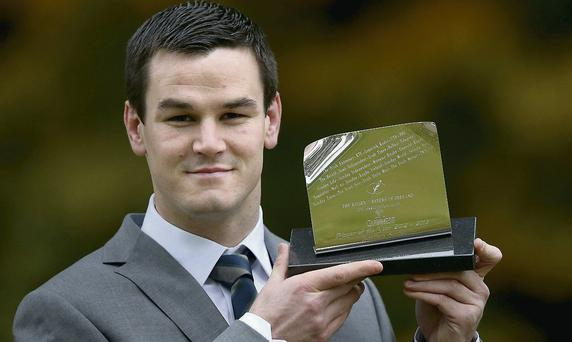 Sexton accepting the Guinness Rugby Writers of Ireland Player of the Year award MATT BROWNE/SPORTSFILE; BILLY STICKLAND/INPHO